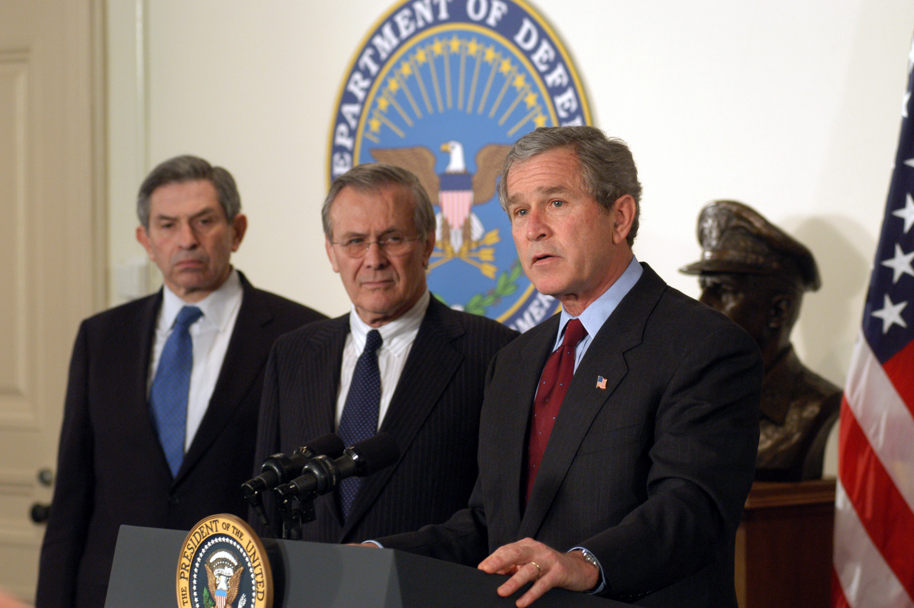 President George W. Bush announces his $74.7 billion wartime supplemental budget request at the Pentagon as Secretary of Defense Donald H. Rumsfeld (center) and Deputy Secretary of Defense Paul Wolfowitz (left) look on.  The President visited the Pentagon to meet with senior defense leadership and to announce the supplemental request which, once appropriated by Congress, will pay for the direct costs of Operation Iraqi Freedom and the global war against terror.  DoD photo by R.D. Ward.  (RELEASED)